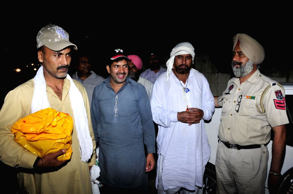 Indian prisoners Sohan Lal, Abdul Majid and Mohammad Maqbool Lone who were released after serving their sentence in Pakistan jails return back to India on June 22, 2017.