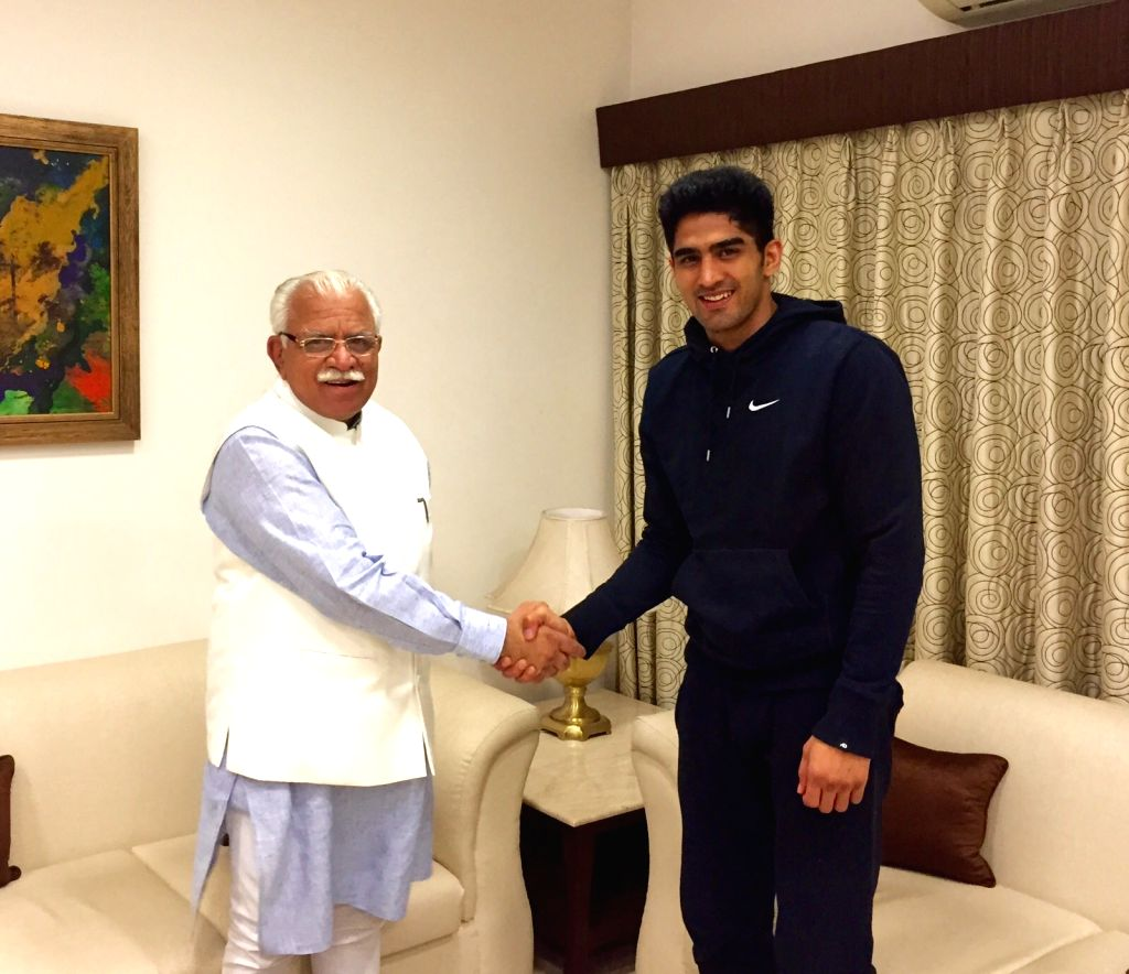 : Indian Professional Boxer Vijender Singh during a meeting with Haryana Chief Minister Manohar Lal Khattar in New Delhi, on Nov 16, 2015. (Photo: IANS). - Manohar Lal Khattar and Vijender Singh