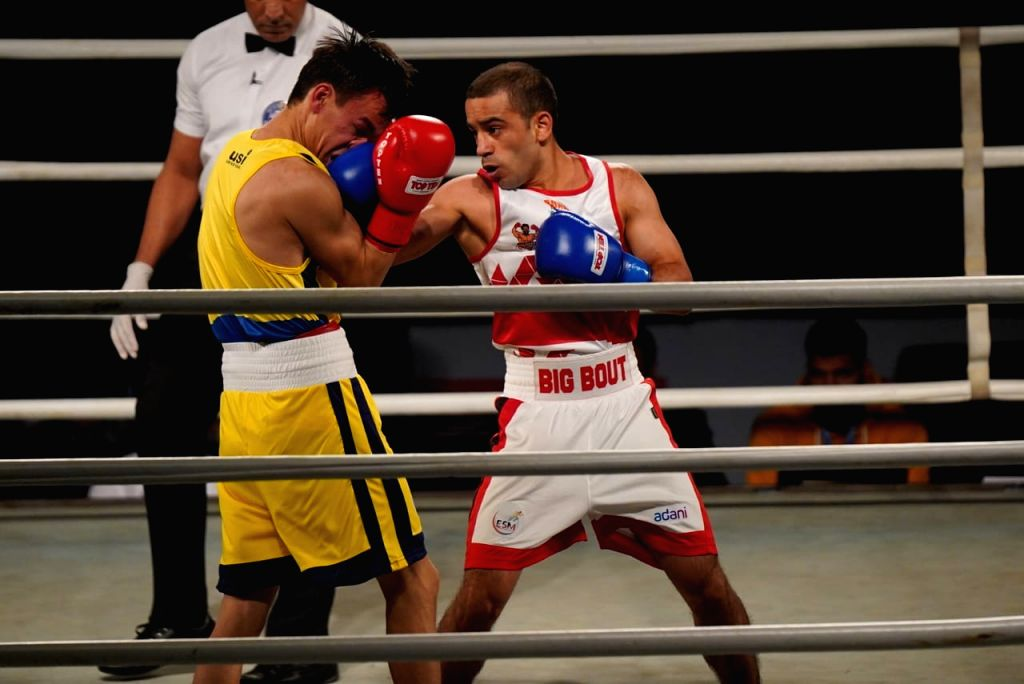Indian pugilist Amit Panghal (in white) of Gujarat Giants in action during Big Bout Indian Boxing League at the Indira Gandhi Indoor Stadium in New Delhi on Dec 7, 2019.