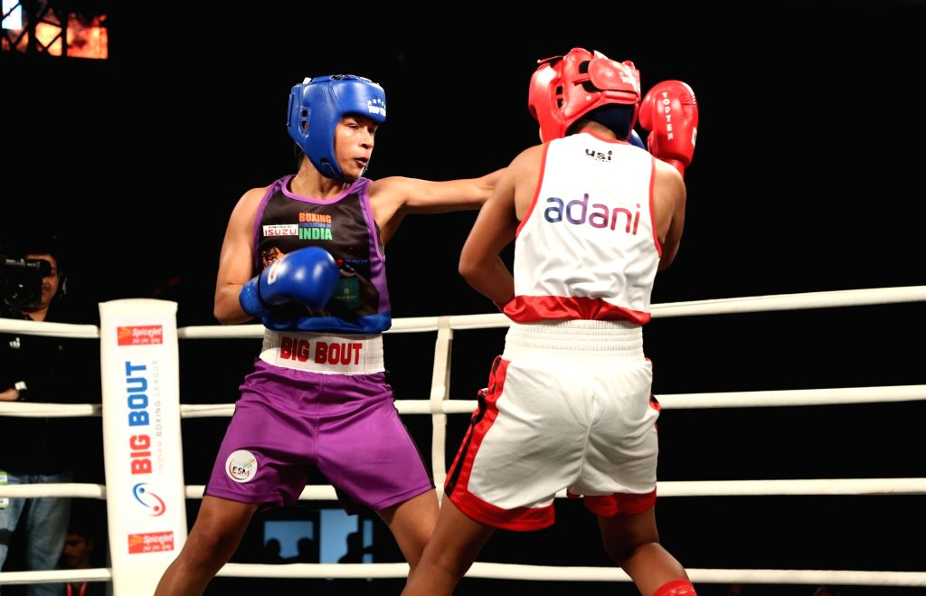 Indian pugilist Nikhat Zareen (in blue) of NE Rhinos in action during Big Bout Indian Boxing League at the Indira Gandhi Indoor Stadium in New Delhi on Dec 7, 2019.