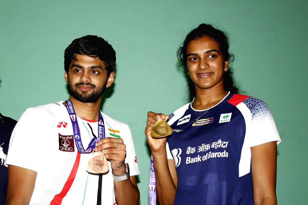 Indian shuttler P. V. Sindhu and B. Sai Praneeth pose with their medals at the BWF World Championships at Gopichand Badminton Academy in Hyderabad on Aug 27, 2019.