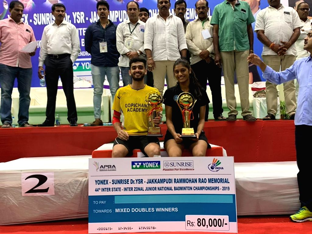 Indian shuttlers Ishaan Bhatnagar and Tanisha Crasto with their mixed doubles trophies during the presentation ceremony of the Yonex-Sunrise 44th Junior National Badminton Championships ...