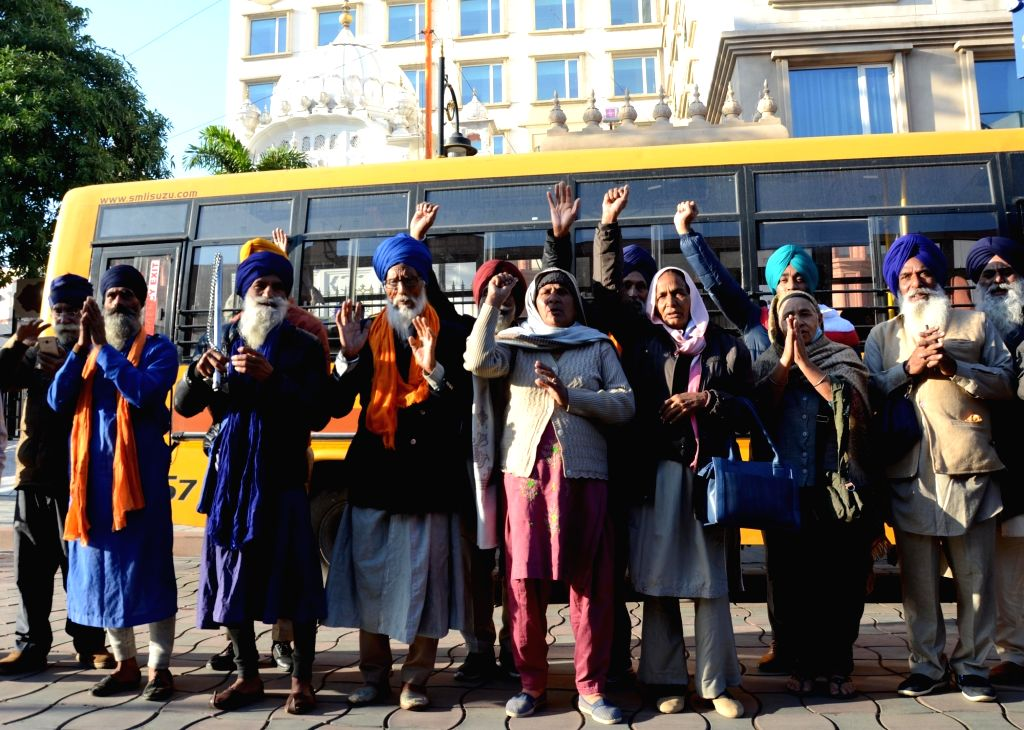 Indian Sikh pilgrims leave for Pakistan to celebrate the 551st birth anniversary of the founder of Sikhism and the first of the ten Sikh Gurus, Guru Nanak Dev, from Amritsar on Nov 27, 2020. - Nanak Dev