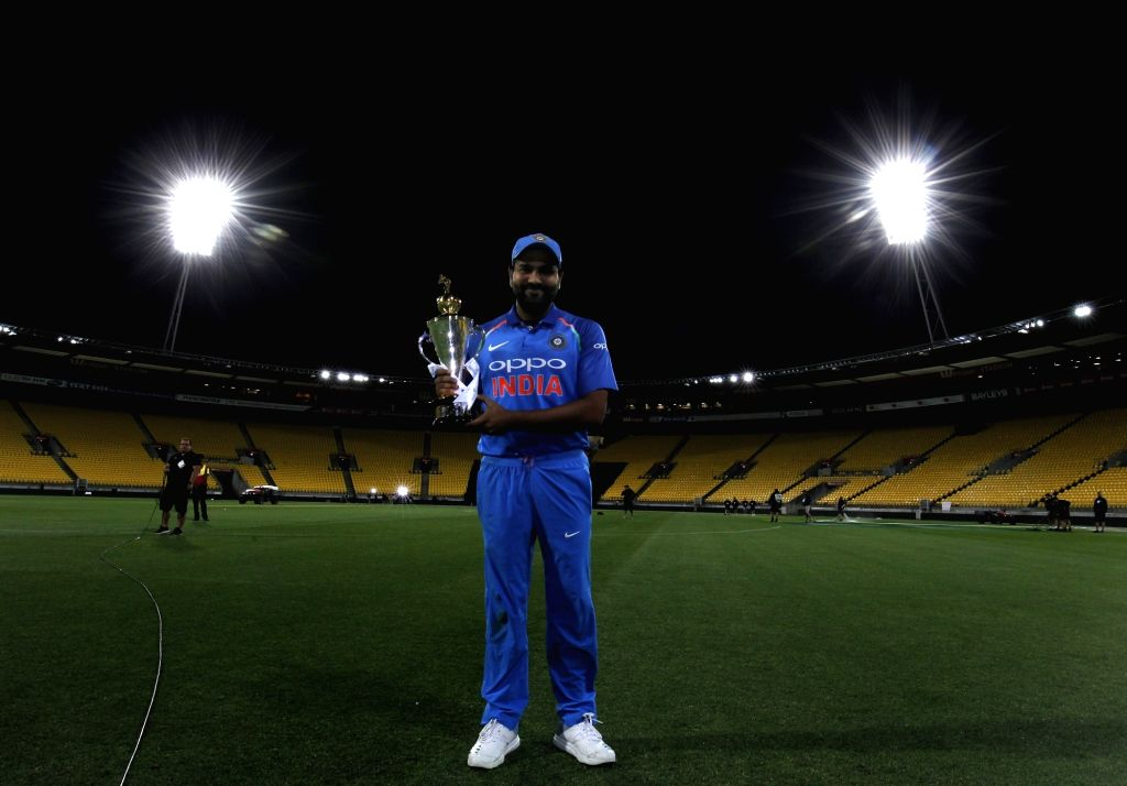 Indian skipper Rohit Sharma poses with the trophy after a 35-run victory against New Zealand in the fifth and final One Day International (ODI) match, thereby clinching the limited overs ... - Rohit Sharma