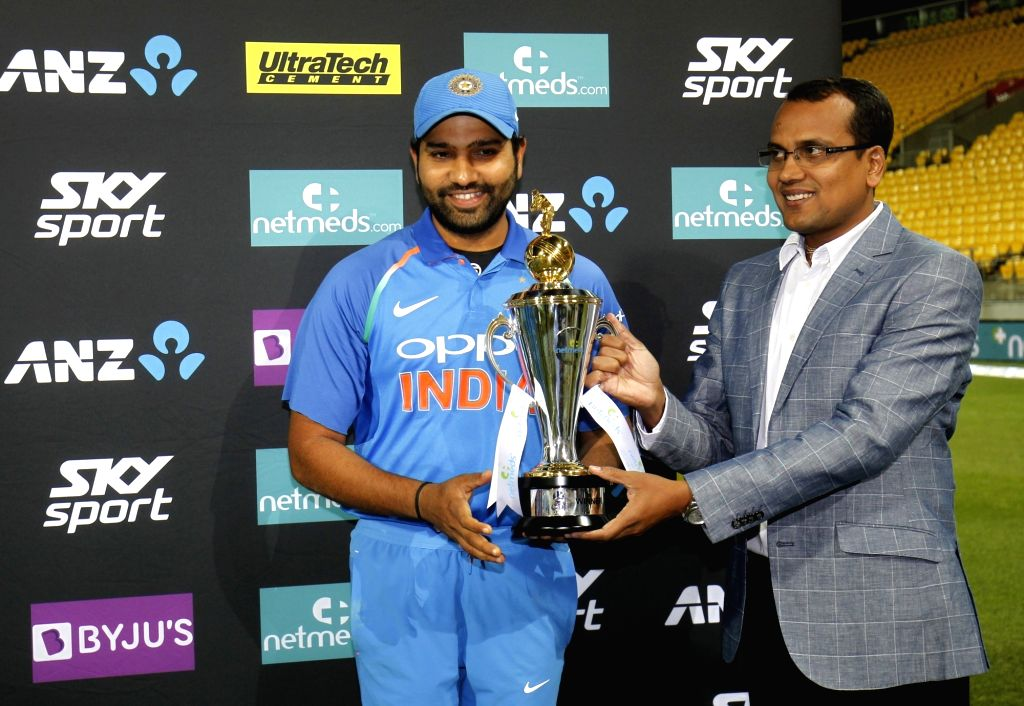Indian skipper Rohit Sharma receiving the trophy after the Indian team notched-up a 35-run victory against New Zealand in the fifth and final One Day International (ODI) match, thereby ... - Rohit Sharma
