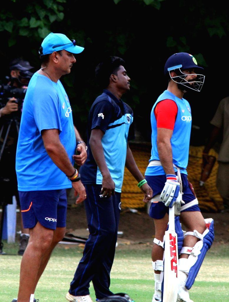 Indian skipper Virat Kohli along with head coach Ravi Shastri during a practice session in Chennai on Sept 16, 2017. - Virat Kohli
