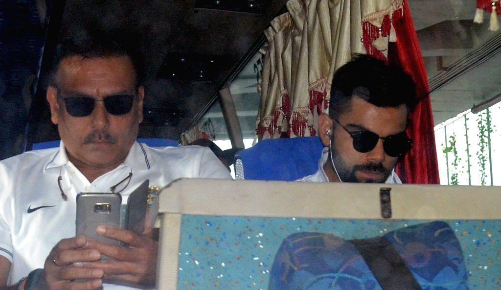 Indian skipper Virat Kohli along with head coach Ravi Shastri arrive at Netaji Subhas Chandra Bose International Airport in Kolkata on Sept 18, 2017. - Virat Kohli