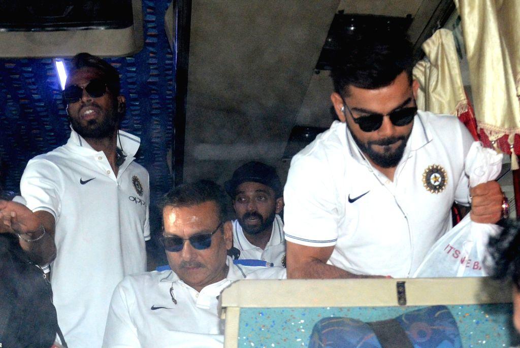 Indian skipper Virat Kohli along with head coach Ravi Shastri arrive at Netaji Subhas Chandra Bose International Airport in Kolkata on Sept 18, 2017. Also seen Indian cricketers Hardik ... - Virat Kohli