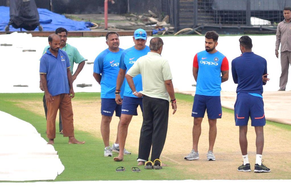 Indian skipper Virat Kohli along with head coach Ravi Shastri and bowling coach Bharat Arun inspects the pitch ahead of the 2nd ODI match against Australia at the Eden Gardens in Kolkata on ... - Virat Kohli
