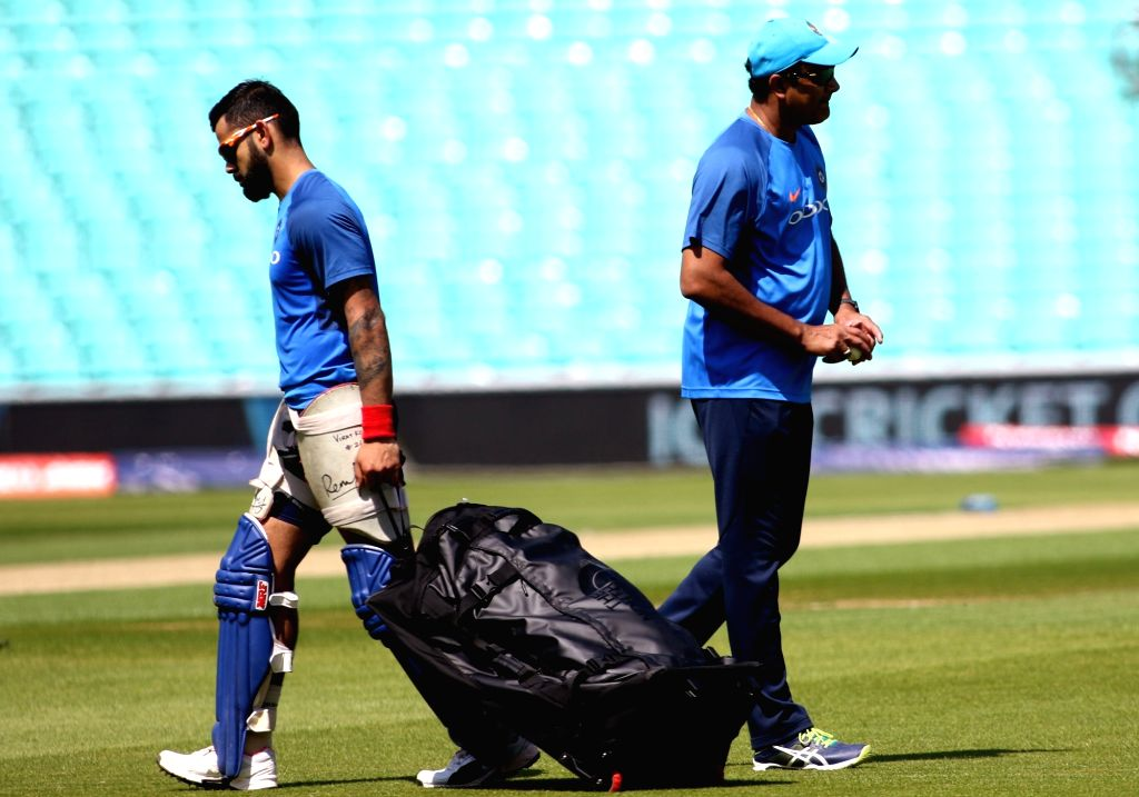 Indian skipper Virat Kohli and coach Anil Kumble during a practice session at the Oval in London on June 17, 2017. - Virat Kohli