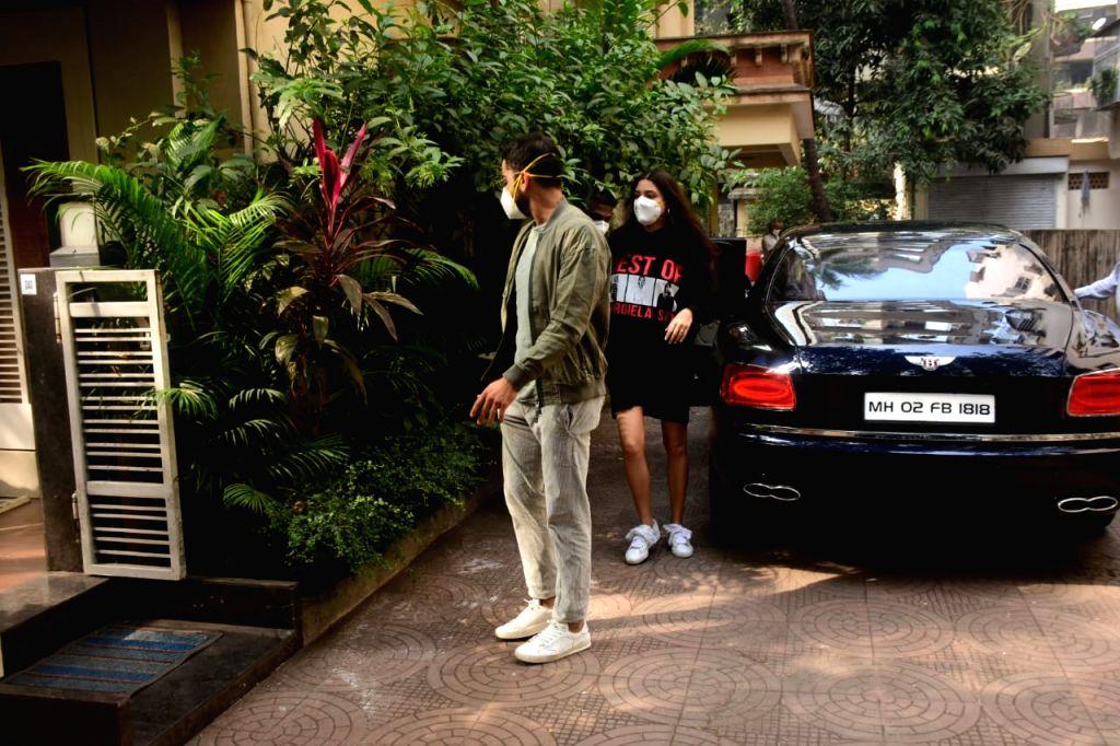 Indian skipper Virat Kohli and his actress wife Anushka Sharma seen at a Bandra clinic, in Mumbai on Jan 7, 2021. - Virat Kohli and Anushka Sharma