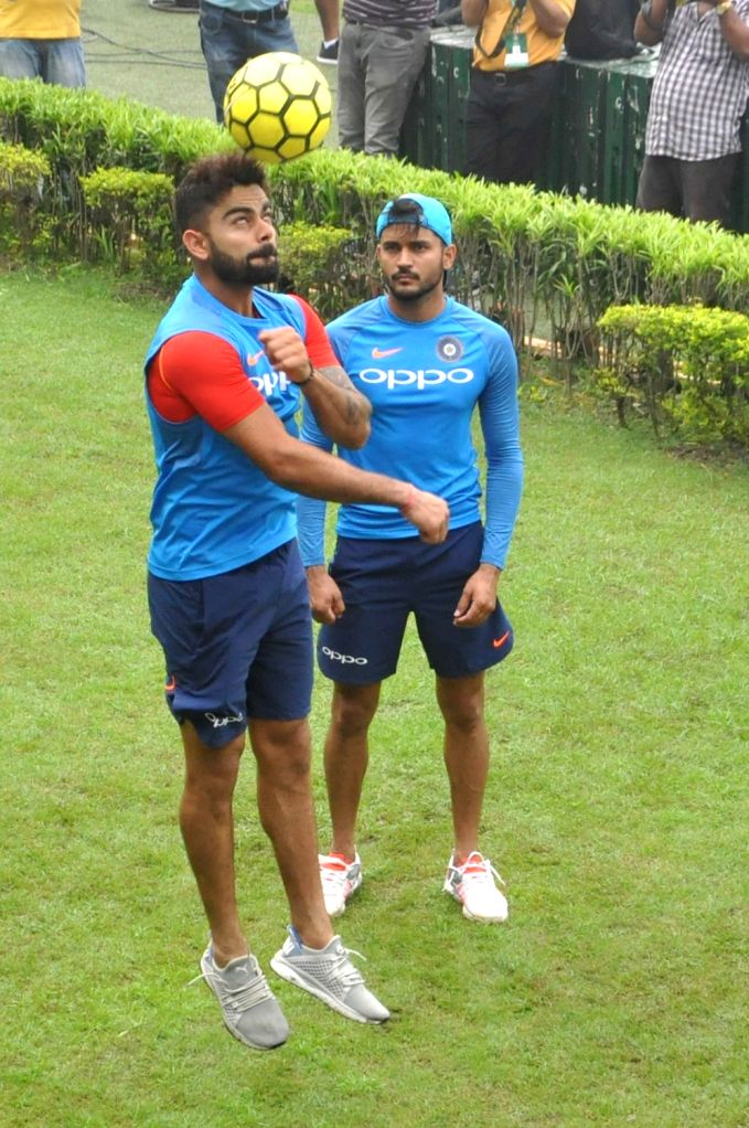 Indian skipper Virat Kohli and Manish Pandey during a practice session at the Eden Gardens in Kolkata on Sept 20, 2017. - Virat Kohli and Manish Pandey