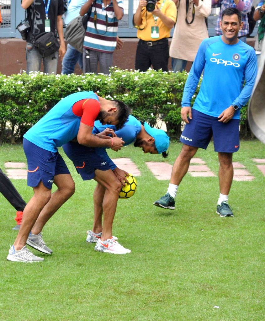 Indian skipper Virat Kohli and MS Dhoni during a practice session at the Eden Gardens in Kolkata on Sept 20, 2017. - MS Dhoni and Virat Kohli