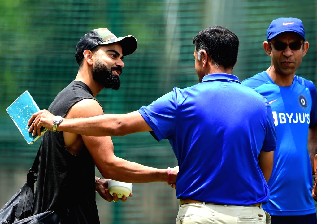 Indian skipper Virat Kohli and National Cricket Academy (NCA) head Rahul Dravid during a practice session ahead of the 3rd T20 match against South Africa at Chinnaswamy Stadium, in ... - Rahul Dravid and Virat Kohli