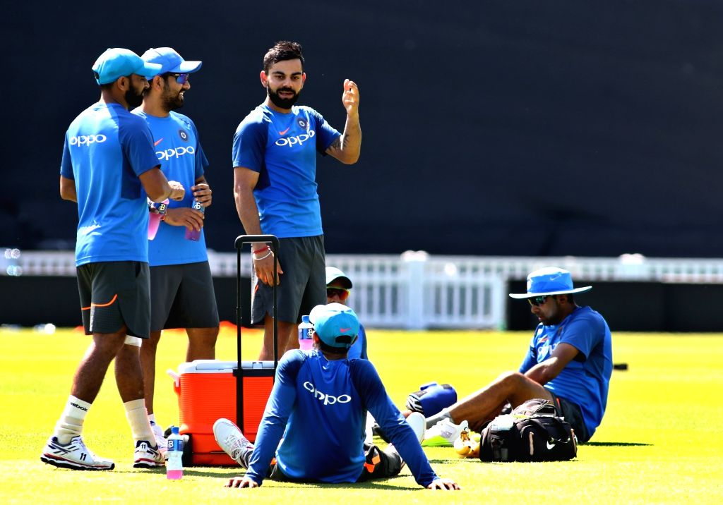 Indian skipper Virat Kohli and Rohit Sharma during a practice session at the Oval in London on June 17, 2017. - Virat Kohli and Rohit Sharma