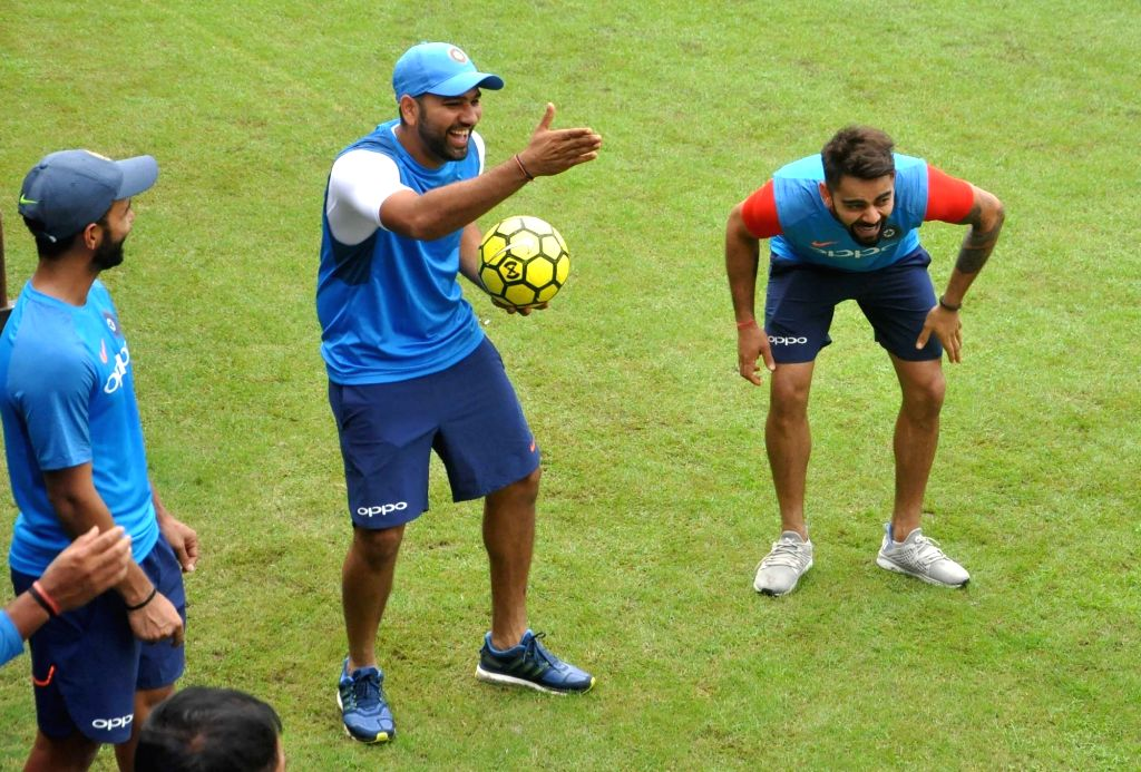 Indian skipper Virat Kohli and Rohit Sharma during a practice session at the Eden Gardens in Kolkata on Sept 20, 2017. - Virat Kohli and Rohit Sharma