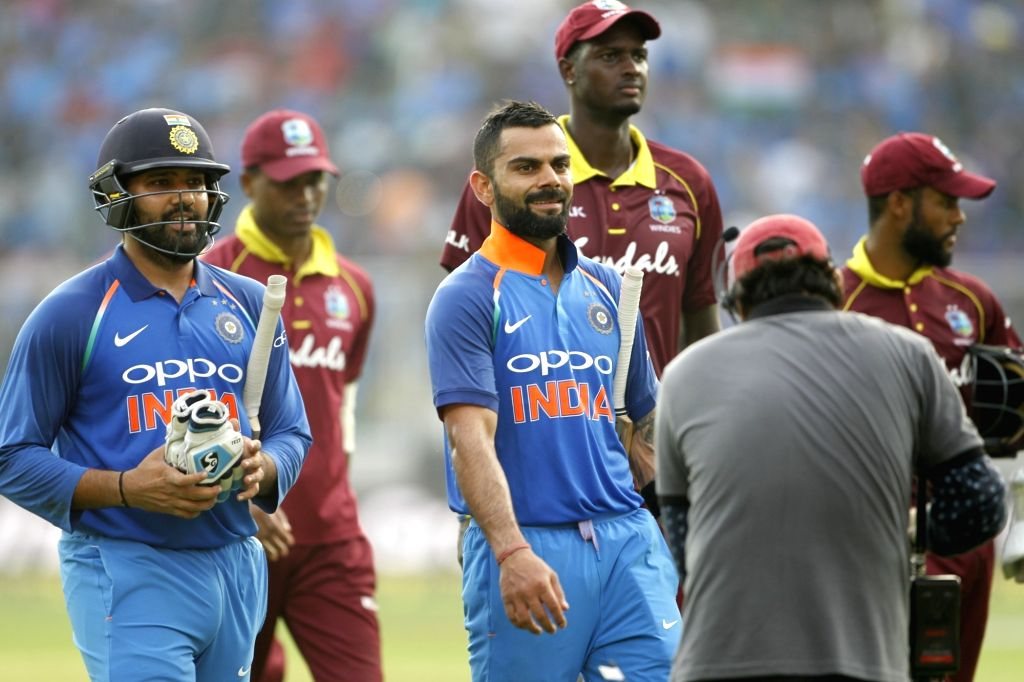 Indian skipper Virat Kohli and Rohit Sharma walk back to the pavilion after winning the fifth and final ODI match against West Indies in Thiruvananthapuram, on Nov. 1, 2018. India ... - Virat Kohli and Rohit Sharma