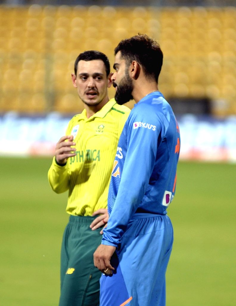 Indian skipper Virat Kohli and South African skipper Quinton de Kock during the presentation after the 3rd T20I match between India and South Africa at M. Chinnaswamy Stadium in Bengaluru ... - Virat Kohli