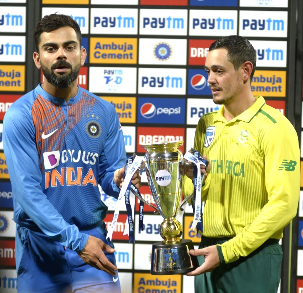 Indian skipper Virat Kohli and South African skipper Quinton de Kock pose with the T20I series trophy during the presentation after the 3rd T20I match between India and South Africa at M. ... - Virat Kohli