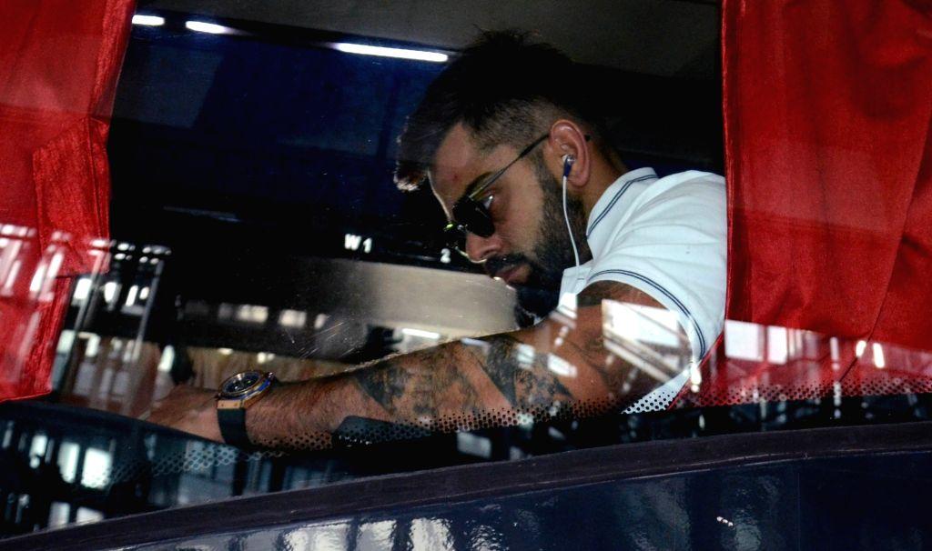 Indian skipper Virat Kohli arrives at Netaji Subhas Chandra Bose International Airport in Kolkata on Sept 18, 2017. - Virat Kohli