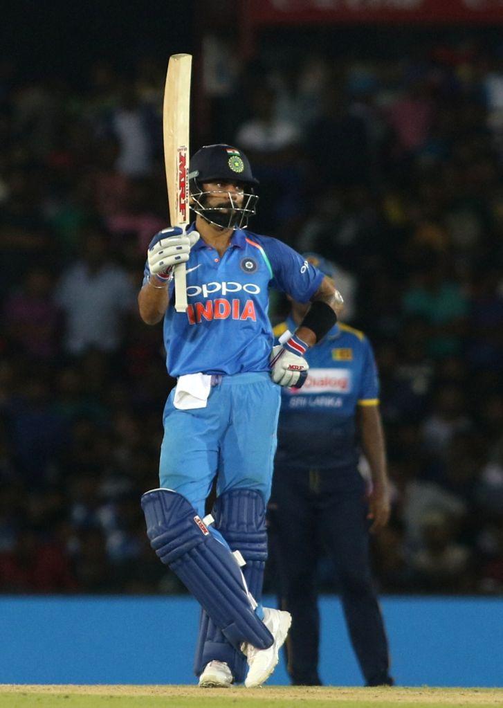 Indian skipper Virat Kohli celebrates his half century during the first ODI International cricket match between India and Sri Lanka at Rangiri Dambulla International Stadium in Dambulla, ... - Virat Kohli