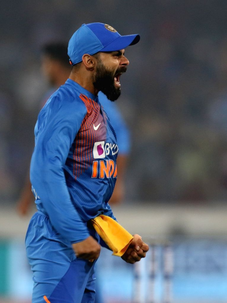 Indian skipper Virat Kohli celebrates the wicket of Evin Lewis during the first T20I match between India and the West Indies at the Rajiv Gandhi International Stadium in Hyderabad on Dec ... - Virat Kohli