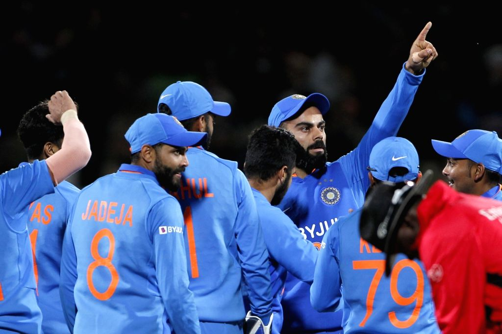 Indian skipper Virat Kohli celebrates the wicket of Henry Nicholls with teammates during the 1st ODI of the three-match series between India and New Zealand at the Seddon Park in Hamilton, ... - Virat Kohli