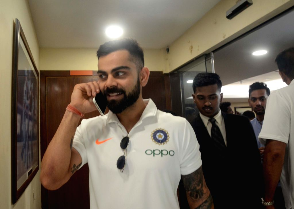 Indian skipper Virat Kohli comes out after addressing a press conference ahead of leaving for England to participate in the ICC Cricket World Cup 2019, in Mumbai on May 21, 2019. - Virat Kohli
