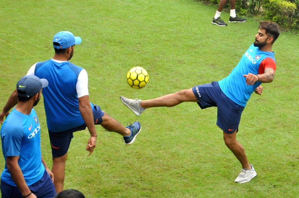 Indian skipper Virat Kohli during a practice session at the Eden Gardens in Kolkata on Sept 20, 2017. - Virat Kohli