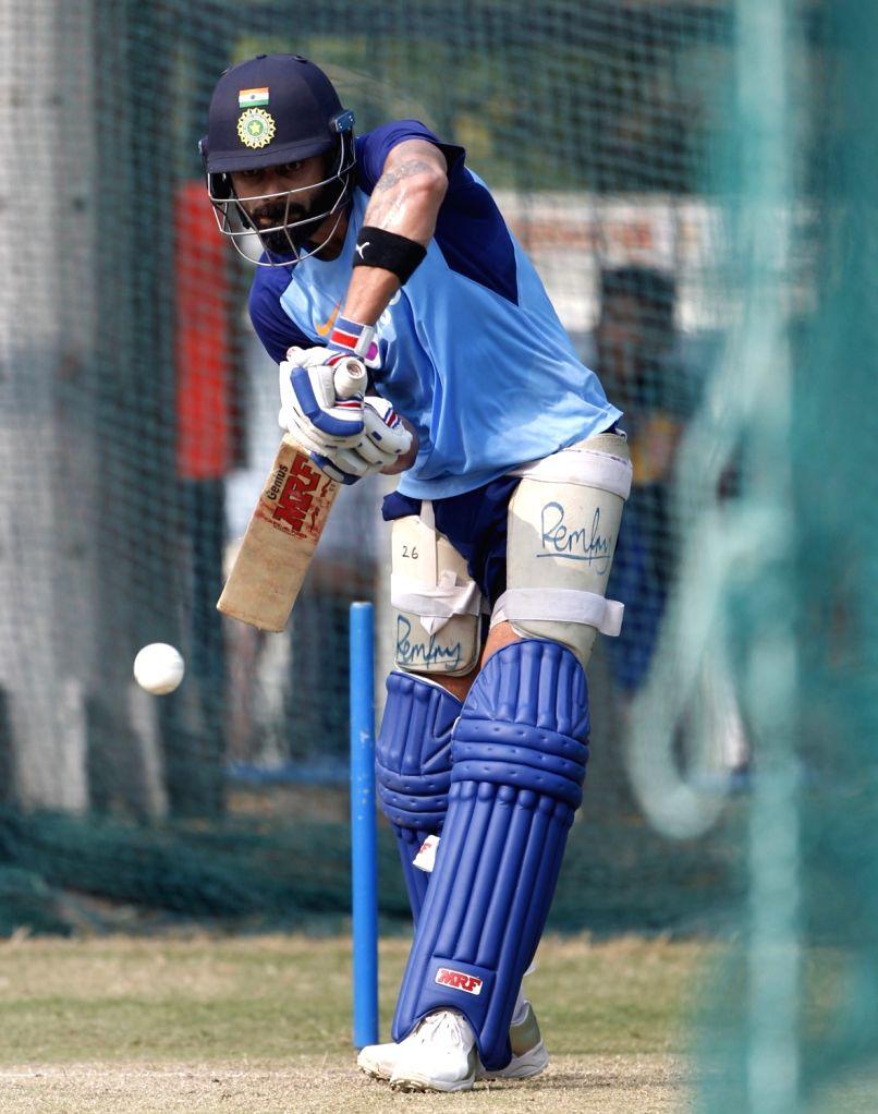 Indian skipper Virat Kohli during a practice session ahead of the first Twenty20 match between India and West Indies at Rajiv Gandhi International Cricket Stadium in Hyderabad on Dec 4, ... - Virat Kohli