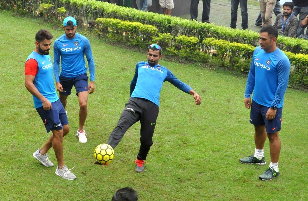 Indian skipper Virat Kohli, MS Dhoni, Ravindra Jadeja and Manish Pandey during a practice session at the Eden Gardens in Kolkata on Sept 20, 2017. - MS Dhoni, Virat Kohli, Ravindra Jadeja and Manish Pandey