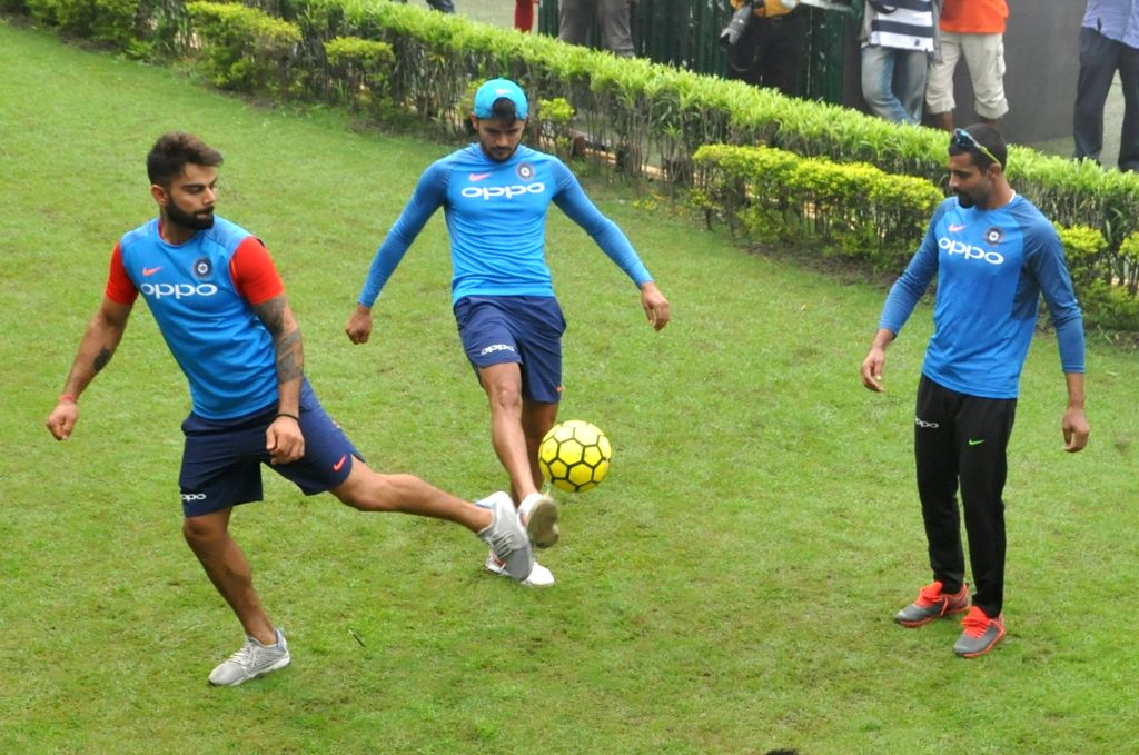 Indian skipper Virat Kohli, Ravindra Jadeja and Manish Pandey during a practice session at the Eden Gardens in Kolkata on Sept 20, 2017. - Virat Kohli, Ravindra Jadeja and Manish Pandey