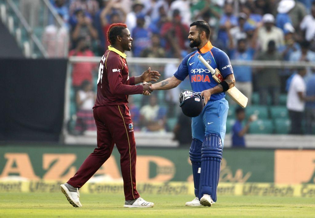 Indian skipper Virat Kohli shakes hand after winning the fifth and final ODI match against West Indies in Thiruvananthapuram, on Nov. 1, 2018. India clinch series 3-1. - Virat Kohli