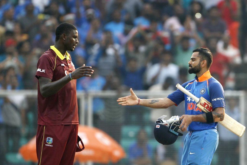Indian skipper Virat Kohli shakes hand with West Indies skipper Jason Holder after winning the fifth and final ODI match against West Indies in Thiruvananthapuram, on Nov. 1, ... - Virat Kohli