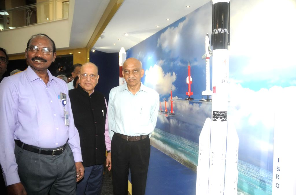 Indian Space Research Organisation (ISRO) Chairmen K. Sivan and A. S. Kiran Kumar with former ISRO Chairman Krishnaswamy Kasturirangan at the launch of a new bust of India's space pioneer ...