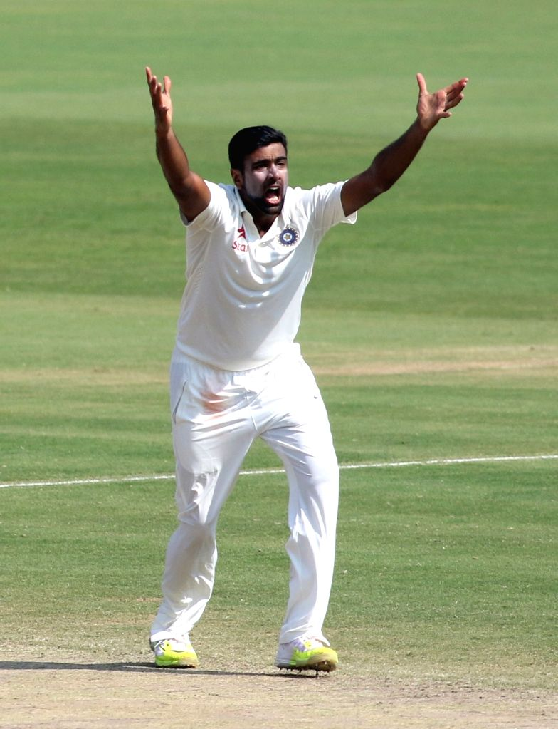 Indian spinner R. Ashwin celebrates fall of wicket during the Day-5 of the second test cricket match between India and England at the Dr. YS Rajasekhara Reddy ACA-VDCA Cricket Stadium ... - Rajasekhara Reddy A