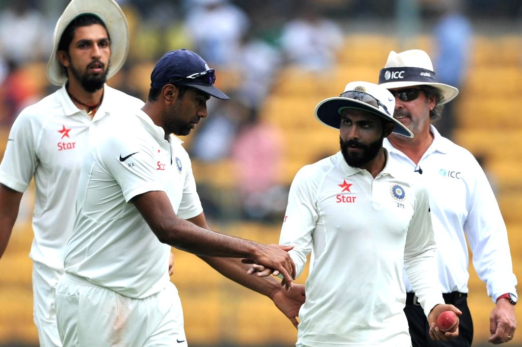 Indian spinner R Ashwin congratulates Ravindra Jadeja on taking 6 wickets on day three of second test match between India and Australia at M. Chinnaswamy Stadium, in Bengaluru on March 6, ... - Ravindra Jadeja
