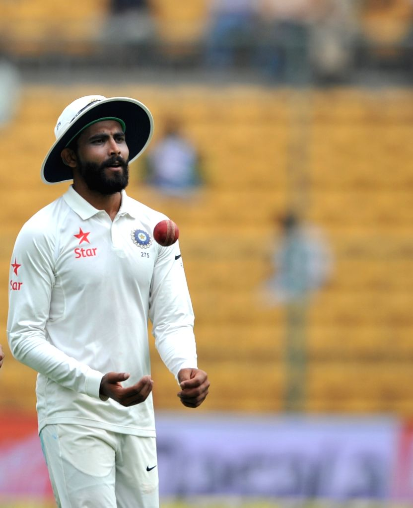 Indian spinner Ravindra Jadeja celebrates taking a wicket on day three of second test match between India and Australia at M. Chinnaswamy Stadium, in Bengaluru on March 6, 2017. - Ravindra Jadeja