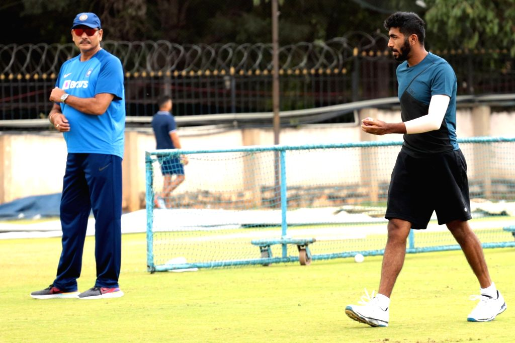 Indian team's Head coach Ravi Shastri and cricketer Jasprit Bumrah during a practice session ahead of the 3rd T20I match against South Africa at M. Chinnaswamy Stadium, in Bengaluru on Sep ...