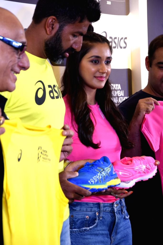 Indian tennis ace Rohan Bopanna and actress Nikita Dutta during the of launch the 'ASICS Limited Edition GEL-NIMBUS 22' and race day t-shirt for the 'Tata Mumbai Marathon' in Mumbai on Dec 5, ... - Nikita Dutta and Rohan Bopanna