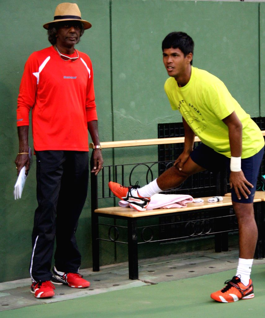 Indian tennis coach Vijay Amritraj during a practice session ahead of Davis Cup 2014 in Bangalore on Sept 8, 2014.