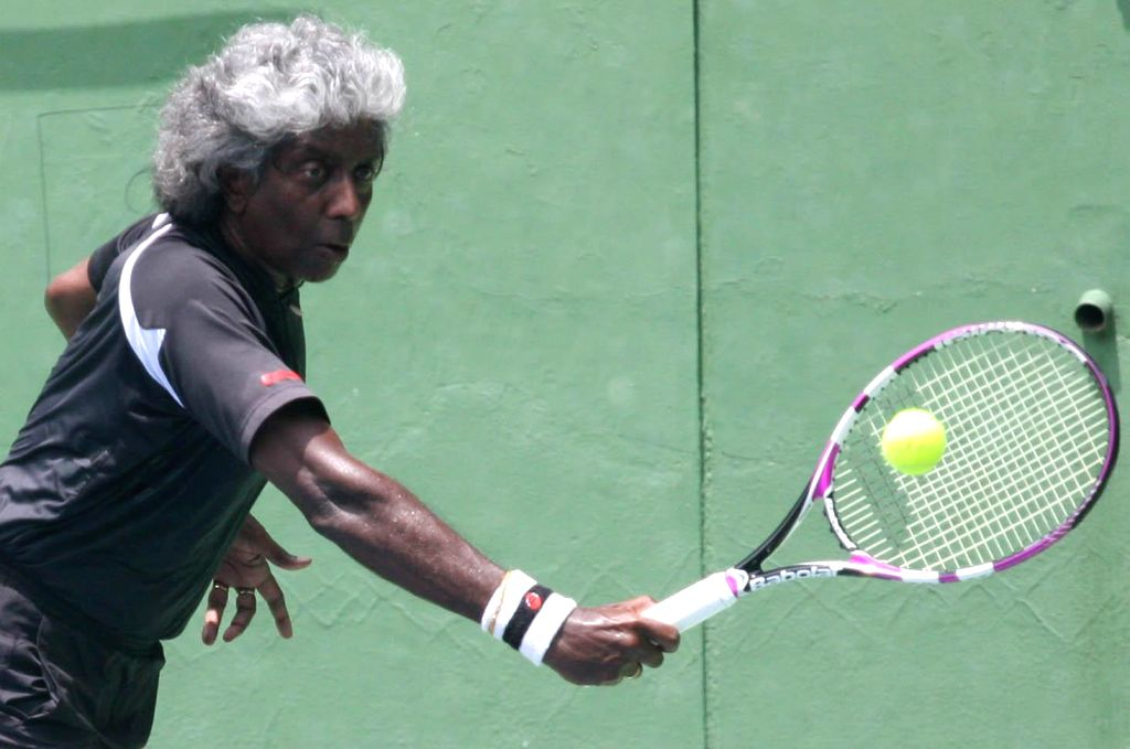 Indian tennis coach Vijay Amritraj in action during a practice session ahead of Davis Cup 2014 in Bangalore on Sept 8, 2014.