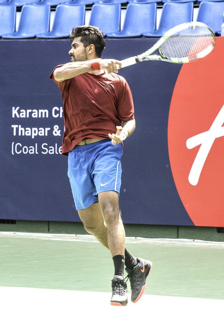 Indian tennis player Christopher Marquis in action against country-mate Vignesh Peranamallur during the qualifiers of the AirAsia Open at the KSLTA, in Bengaluru on Oct 17, 2015.