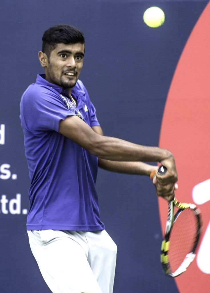 Indian tennis player Jayesh Pungliya in action against country-mate Niki Poonacha during the qualifiers of the AirAsia Open at the KSLTA, in Bengaluru on Oct 17, 2015.