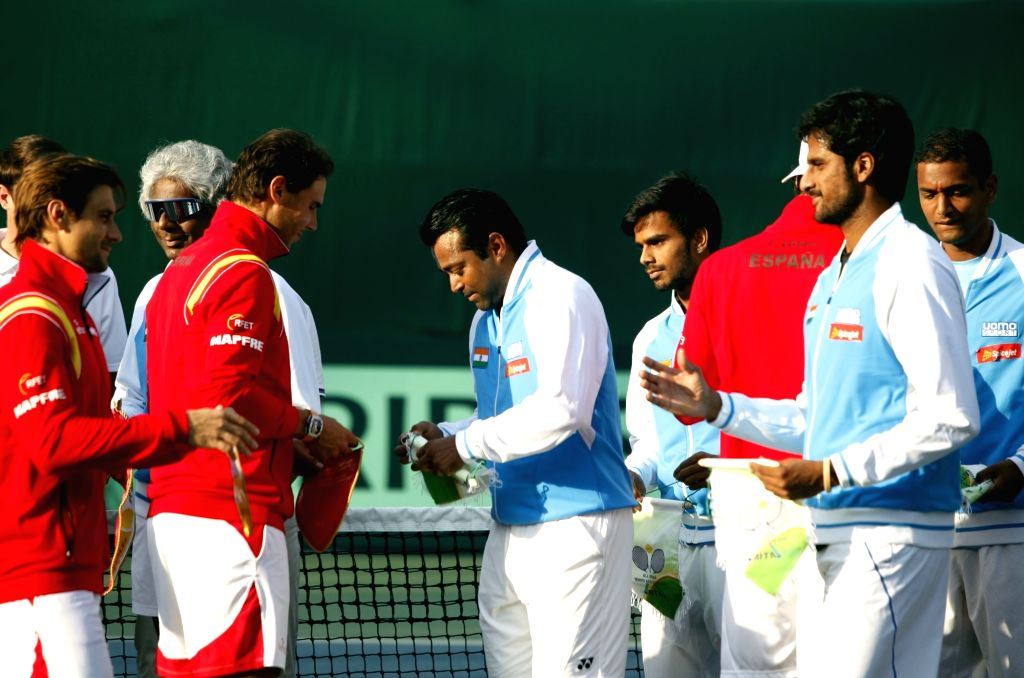 Indian tennis player Leander Paes and Spanish tennis player Rafael Nadal during the Davis Cup World Group playoff opening ceremony at the Delhi Lawn Tennis Association complex in New Delhi ...