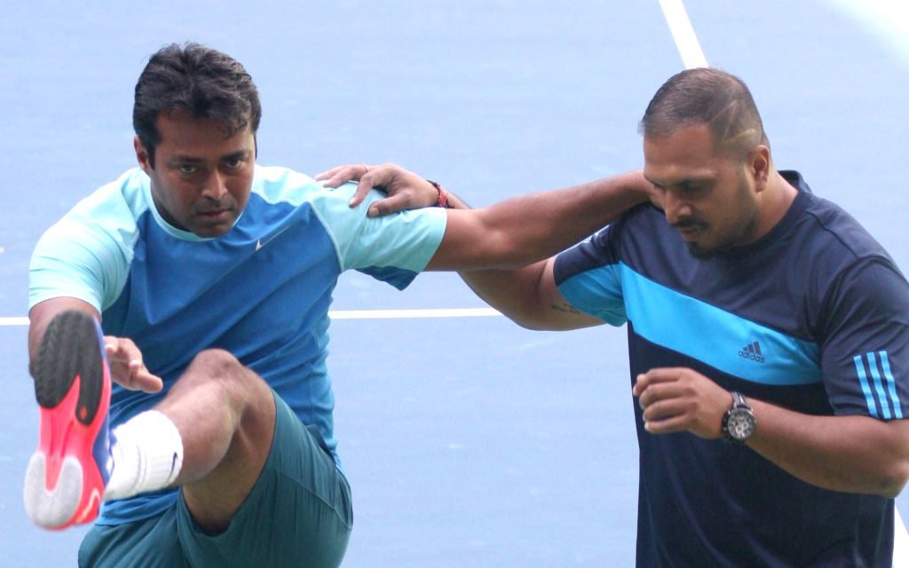 Indian tennis player Leander Paes during a practice session ahead of Davis Cup 2014 at KSLTA in Bangalore on Sept 9, 2014.