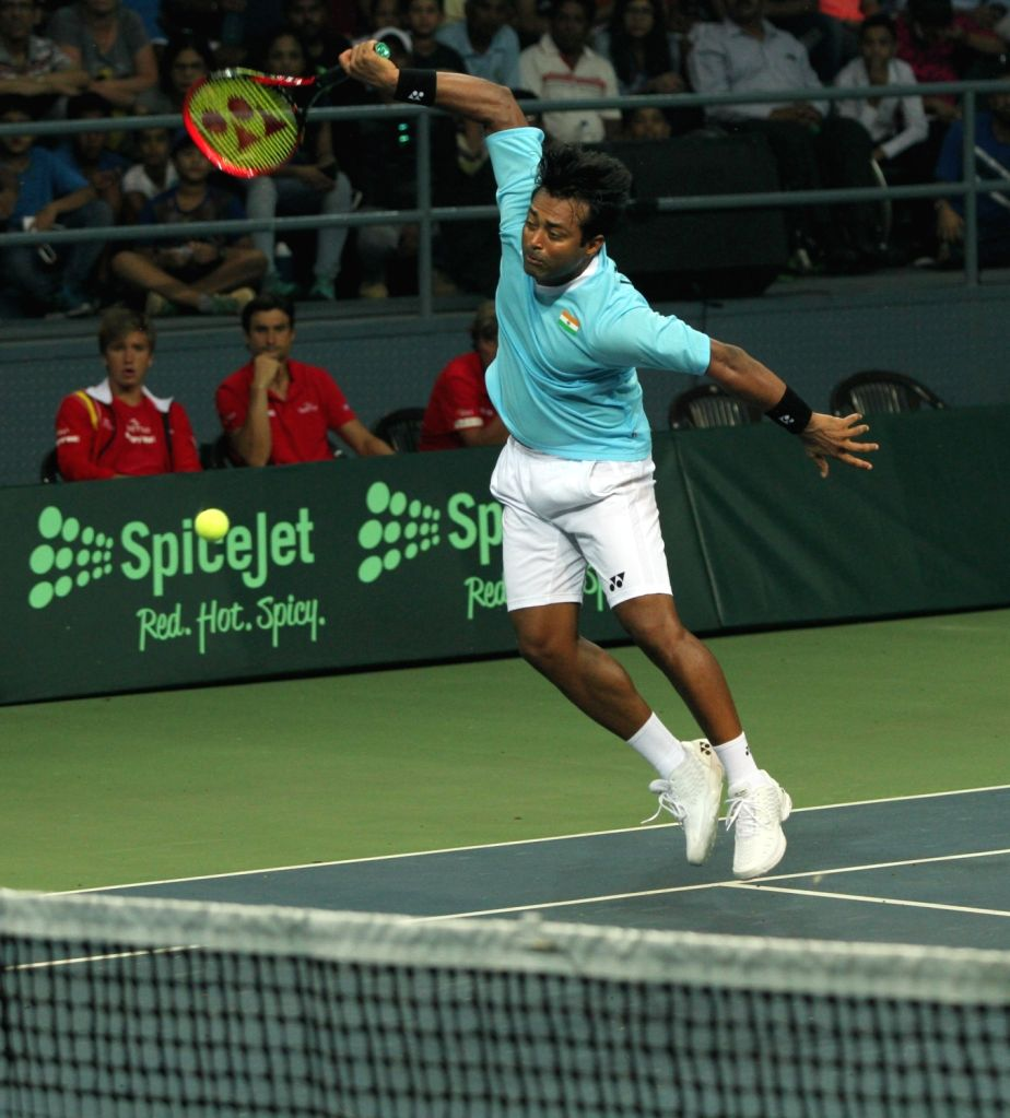 Indian tennis player Leander Paes in action during Davis Cup World Group Play-off doubles match against Spain's Rafael Nadal and Marc Lopez at RK Khanna Tennis Stadium in New Delhi on Sept ...