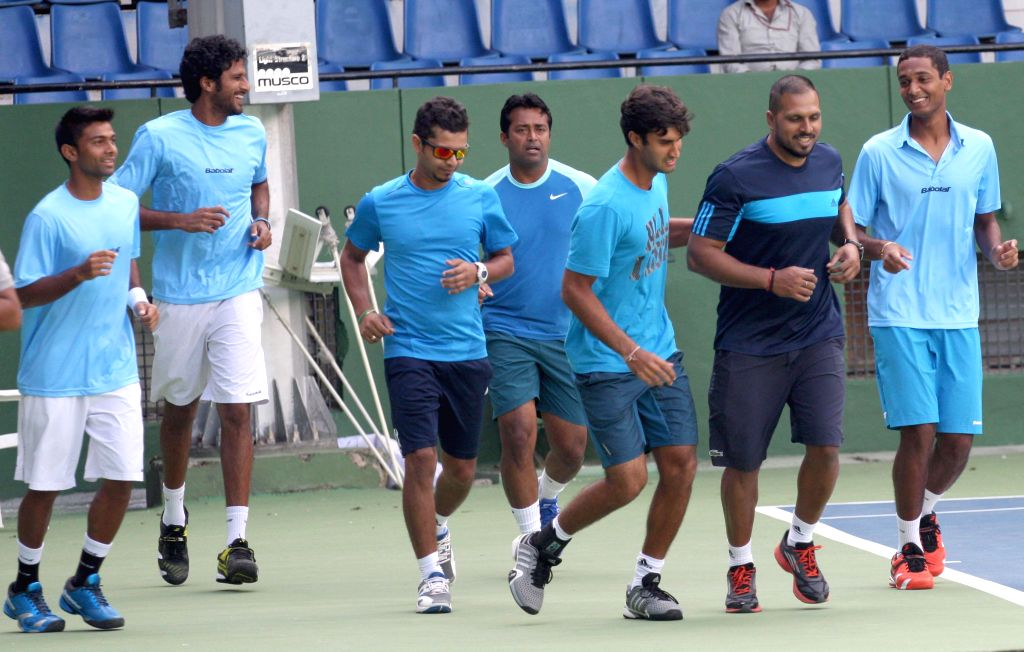 Indian tennis player Leander Paes with others during a practice session ahead of Davis Cup 2014 at KSLTA in Bangalore on Sept 9, 2014.