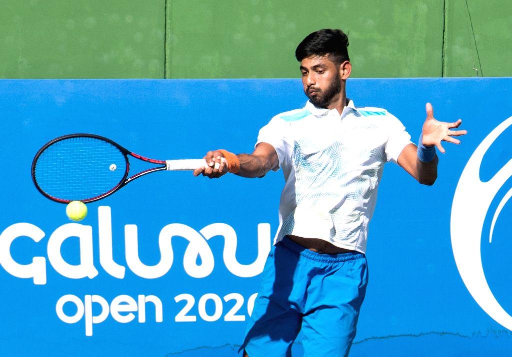 Indian tennis player Niki Kaliyanda Poonacha in action against Lukas Rosol of Czech during the Bengaluru Open 2020 at Cubbon Park, in Bengaluru on Feb 11, 2020.