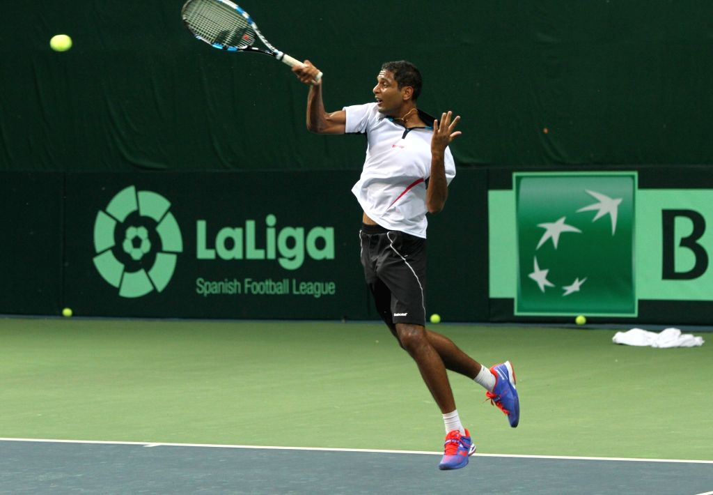 Indian tennis player Ramkumar Ramanathan in action during a practice session ahead of Davis Cup at DLTA in New Delhi on Sept 15, 2016.